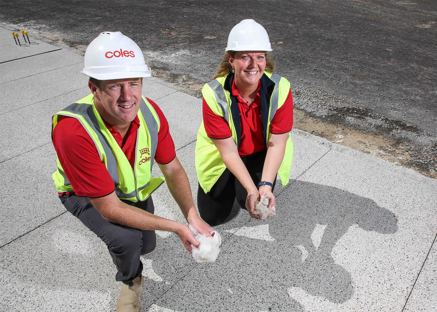 Coles Senior Project Manager Luke Hill with Coles State Construction Manager Victoria Fiona Lloyd at Coles Cobblebank with polyrock